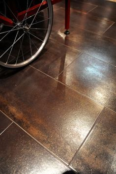 flooring is porcelain, 12X24 tiles in graphite, depending on where you're standing you can see hues of grey metal, chocolate brown, shimmery copper