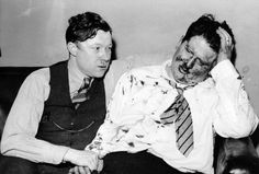 "Walter Reuther, left, and Richard Frankensteen, after being beaten bloody by Ford Motor Company's anti-union thugs at the ""Battle of the Overpass"" in Dearborn, Michigan, May 26, 1937 Photo credit: Wayne State University Reuther Library Archives"