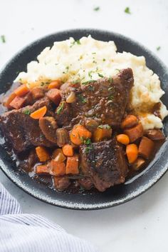Fall-off-the-boneBraised Short Ribs are unbelievably easy and made in just one pot! Tender cooked ribs in a delicious, rich sauce with carrots and onions.