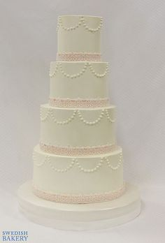 European Buttercream Wedding Cake With Pearl Swags And Double Base Ribbon Lace Provided By Couple Not Edible
