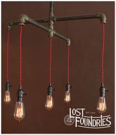 Industrial pipe cross chandelier design. Gramme by Lost Foundries.