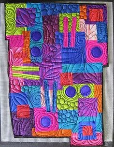 gorgeous colors, interesting shape, but it's the quilting that makes this something special!