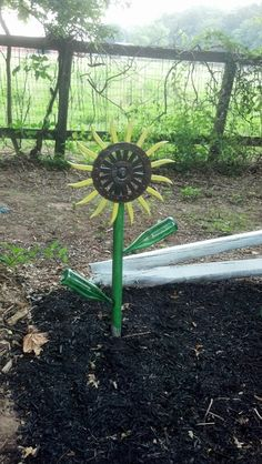 Sunflower, john deere rotary hoe metal yard art
