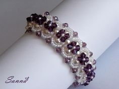X's and O's - The pattern is for sale HERE https://store.jewelrymakingmagazines.com/products/bb9pdf0922__Xs-and-Os OR HERE https://www.etsy.com/listing/103373557/bracelet-beading-pattern-pdf-ohdonna-xs