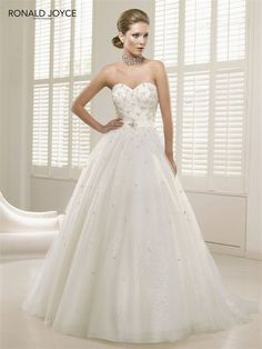 Ronald Joyce has exceeded our expectations with his stunning new collection for 2013 and we have several now featured in our Upstairs Couture Salon. This stunning ballgown is his cover feature and is showcased now in our Salon. Call today to see this stunner in person! We may even let you try it on!
