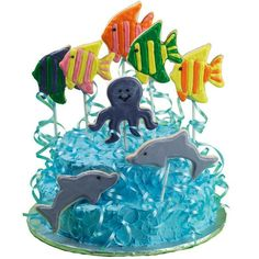 Fun Under The Sea Cake and Cookies - Set the stage for seafaring fun! Use cutters in our 50-Piece Animal Pals Cutter Set create fish, octopus and dolphin cookies. Energize the creatures with bright-colored Ice-A-Cookie Ready-To-Use Cookie Icings.