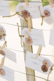 Cute escort cards with little rustic flowers