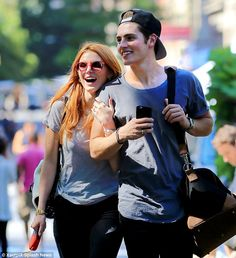 In sync: The 17-year-old actress and the 23-year-old British actor were seen holding hands...