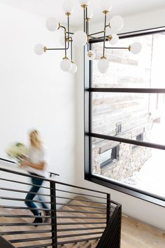 Modern Mountain Home Staircase, Chandelier and 2-story windows    Studio McGee