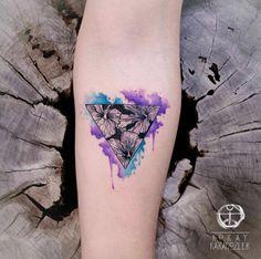Triangular watercolor piece by Koray Karagozler