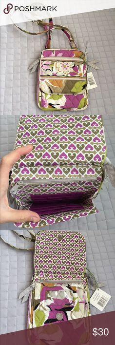 Vera Bradley Mini Hipster Bag Beautiful brand new Vera Bradley Mini Hipster bag in gorgeous retired Portobello Road pattern. Pretty floral design lined with adorable purple and green heart pattern. Long, adjustable strap, front zip pocket, back large slit pocket. Front opens to reveal ID slot and inside contains 6 slots for credit cards and very secure inner zip pocket. Big zip pocket reveals larger area for more storage. Vera Bradley Bags Crossbody Bags