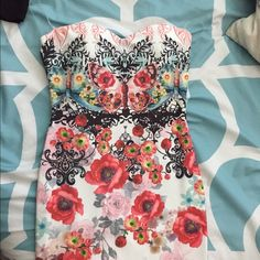 Crazy colorful mini dress This is a crazy printed mini dress with a sweetheart neckline. Bought brand new online and doesn't fit me so I'm selling it!!! No size on it but it would fit a s/m Dresses Mini