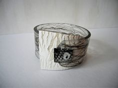 """""""Conventional Tribe"""" - resin and polymer clay bangle by Sonya Girodon."""