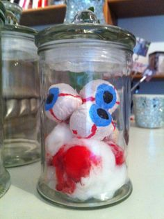 I made some eyes for a couple of years ago and then I found this cool jar and put food coloring in as blood Diy Halloween