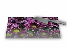 "Maroon and White Mums Glass Cutting Board by Blooming Vine Design. $46.39. Maroon or burgundy colored mums with white petal edges and bright yellow centers create a carpet of flowers on this cutting board.The photo-quality printing is permanently embedded into the back of the tempered glass. Non-skid feet protect the counter and keep the cutting board firmly in place. Makes an excellent gift that will be cherished for years to come. 11.3W x 15.3""L x 0.2""HDishw..."