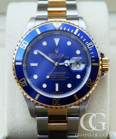 Excellent quality pre-owned Rolex Submariner with blue dial & bi-colour bezel & bracelet from 1996. Original box and papers with 2 year warranty.
