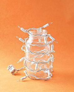 Safer Way to Light a Pumpkin ~ Wrap a strand of 20 lights around a glass jar, and secure wires with tape. Cut a hole in the hollowed-out pumpkin for the cord, and place jar inside.
