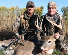 Dale Earnhardt Jr., right, enjoys bowhunting and has known Realtree camouflage founder Bill Jordan, left, for years.
