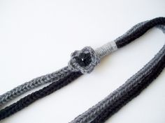 Grey and black necklace with crochet flower - knitted necklace - wool necklace - statement necklace  - infinity scarf