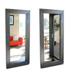 What a terrific hidden room idea. Using a mirror where you step through the frame!