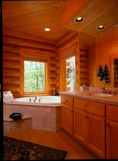 A log home bathroom is like being at your own personal spa getaway! www.hiawatha.com