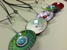 Enameled pendants |  Source no longer available; Another pinner stated that they looked like Kristen Denbow work.