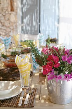 Love how these metal buckets are understated and unexpected with such gorgeous and vibrant flowers