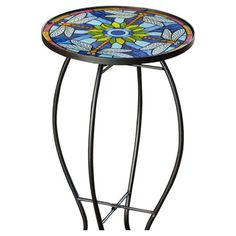 With a beautiful Tiffany-inspired glass top, this scrolling metal side table draws the eye with vibrant dragonfly details.  Product:...