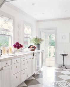 Great painted wood floors in this white kitchen