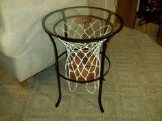 Materials: Ikea table, small hooks, long skinny hooks, basketball net, magnet of your favorite team, super glue, black spray paint, a saw to cut off the flowery part, rubber feet to make it into a trivet