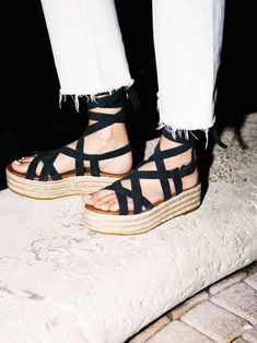 Vegan Milly Platform Sandal | Strappy platform espadrilles featuring ankle straps with an adjustable buckle and wrap tie detailing. Padded footbed for extra comfort.