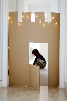 Fantastic idea for a DIY project. A cardboard castle entrance to a childs room.
