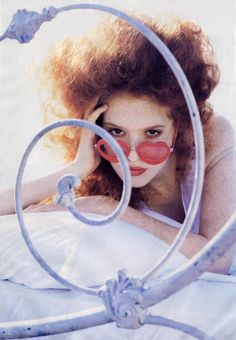 Maayan Keret wearing heart sunglasses for Elle US, circa 1995