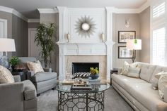 Notice the contrast between the plush upholstery and textured rug in this living room.