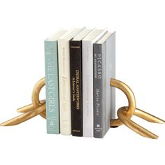 Cyan Design Gold Locks Decorative Bookends ($93) ❤ liked on Polyvore featuring home, home decor, small item storage, books, decor, fillers, accessories, book-end, gold home accessories and gold bookends
