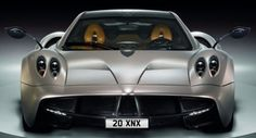 """The Pagani Huayra -- it's pronounced """"h-wire-a"""" -- is the long-awaited successor to the Zonda. Check out the Pagani Huayra in this first ride article brought to you by the automotive experts at Motor Trend. Pagani Huayra Price, Pagani Zonda R, Pagani Car, Luxury Sports Cars, Plates For Sale, Super Sport Cars, Gt Cars, Car Wallpapers, Mercedes Amg"""