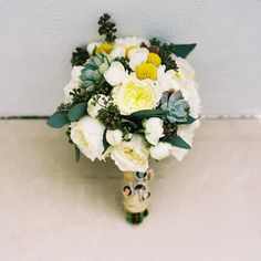 billy button, succulent, and eucalyptus bouquet // photo by KatBraman.com // flowers by CreationsProduction.com