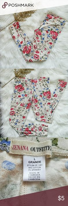 Zenana Outfitters women girls floral leggings These are a pair of creme colored leggings covered with red and blue flowers. They are a size large in women/girls. They are about 37 inches in length with a little bit of walking wear in the inner thigh. Zenana Outfitters Pants Leggings