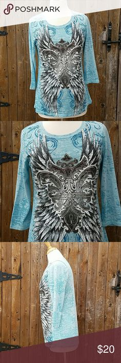Rock 47 by Wrangler Blue Burnout 3/4 Sleeves Top Blue Burnout 3/4 Sleeves Bust is 38 inches Sleeve Length is 17 inches Length of top is 27 inches Polyester & Cotton Blend Rock 47 by Wrangler Tops