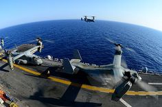 RED SEA (June 30, 2013) MV-22 Ospreys conduct flight operations aboard the amphibious assault ship USS Kearsarge (LHD 3). Kearsarge is the flagship for the Kearsarge Amphibious Ready Group and, with the embarked 26th Marine Expeditionary Unit (26th MEU), is deployed in support of maritime security operations and theater security cooperation efforts in the U.S. 5th Fleet area of responsibility. (U.S. Navy photo by Mass Communication Specialist 2nd Class Corbin J. Shea)
