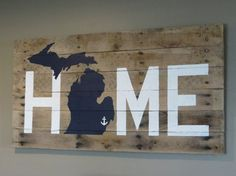***Made To Order*** ***Customizeable***   Michigan Home Sign  -The sign is approximately 20 high x 40 wide and is made out of reclaimed pallet wood.  -The letters are 11.25 tall in white paint and o in home is the state of Michigan .  -The state of Michigan color can be any color in the color sample picture. Please make your selection from the drop down menu. If you would like a different color please let me know and we can work out the details.  -You can add any symbol you would like to…