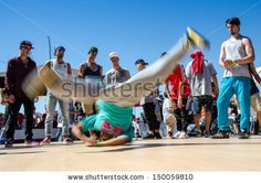VIGO, SPAIN - AUGUST 10: B-Boying crews warmup at the O Marisquino XIII on august 10, 2013 in Vigo, Spain. - Shutterstock Premier
