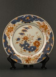 Qianlong - Chinese Imari plate with central scholar's rock and foliage decoration, gilded on the rim with lotus scroll design