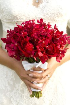 red roses and red mokara orchids bouquet