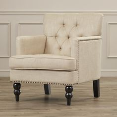 Features:  -The nailhead trim does NOT extend around to the backside of the chair.  -Construction Material: Plywood, birch frame, wood legs, foam fill, microfiber upholstery and nailhead trim.  -Nailh
