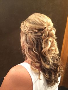Half up half down updo with a couple accent braids @Salon8736