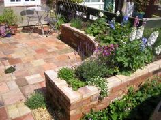 Raised Garden Beds Design on Curved Raised Bed Made Of Reclaimed Brick -