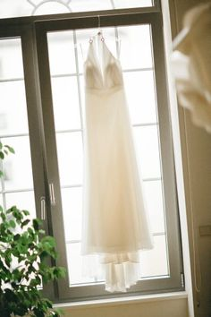 Easy wedding dress hanging in the window. Simple Weddings, Groom, Dress Shoes, Window, Bride, Wedding Dresses, Easy, Wedding Photography, Formal Shoes