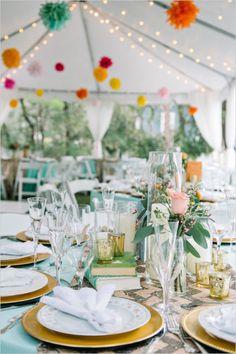 Colorful pom pom decor at tent wedding reception. Captured By: Dear Wesleyann #weddingchicks http://www.weddingchicks.com/2014/06/19/colorful-florida-panhandle-wedding/