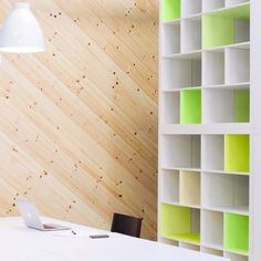 """8.) Give your large shelves some <a href=""""http://www.flaxandtwine.com/2014/06/kallax-ikea-hack-neon-yellow-panyl/"""" target=""""_blank"""">pops of color</a>."""